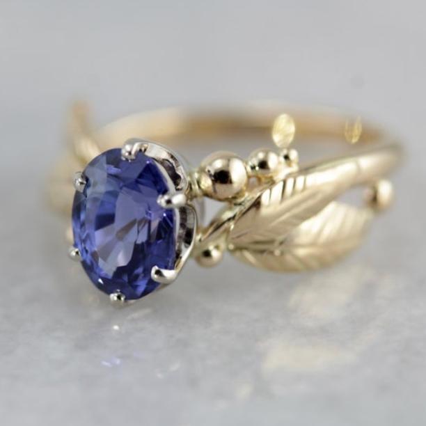 Indigo Blue Sapphire Gemstone set in a Vintage Leaf and Berry