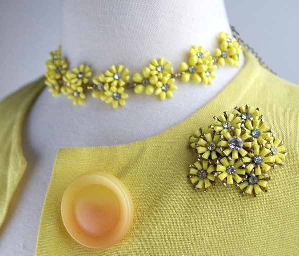 1950s vintage yellow celluloid floral rhinestone brooch and necklace from shedevilvintage on Etsy